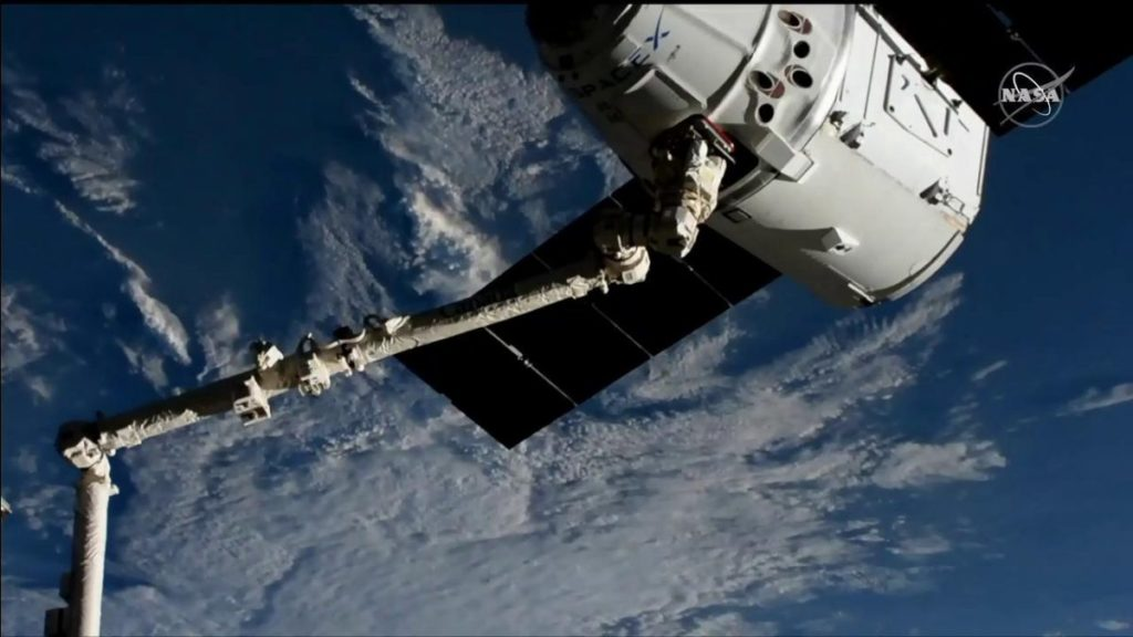 SpaceX Dragon Arrives at Space Station with Space Taxi Docking Mechanism and Science Experiments