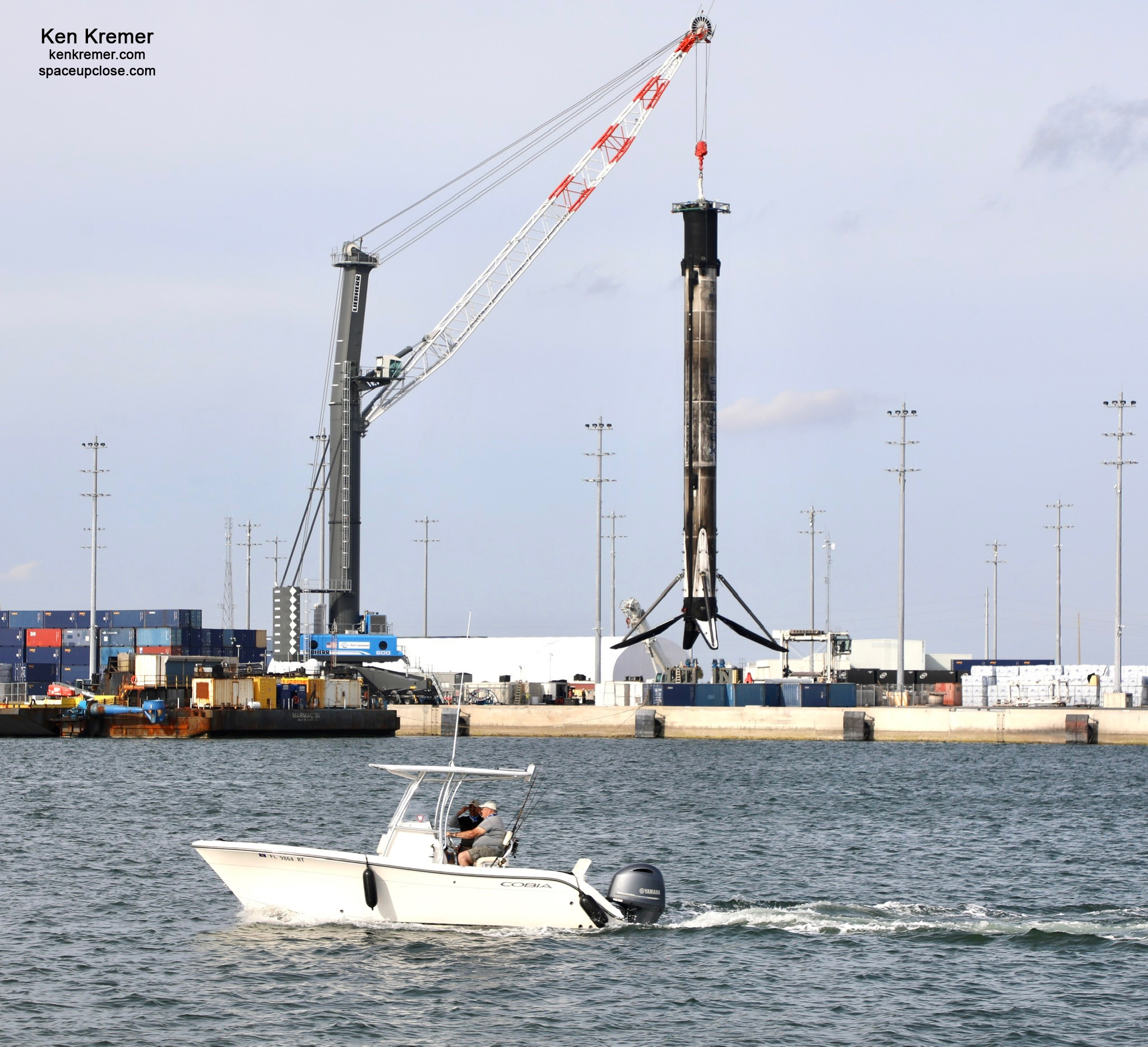 2nd Recovered SpaceX Falcon 9 in 2 Days Returns to Port Canaveral, Hoisted off Droneship: Photos