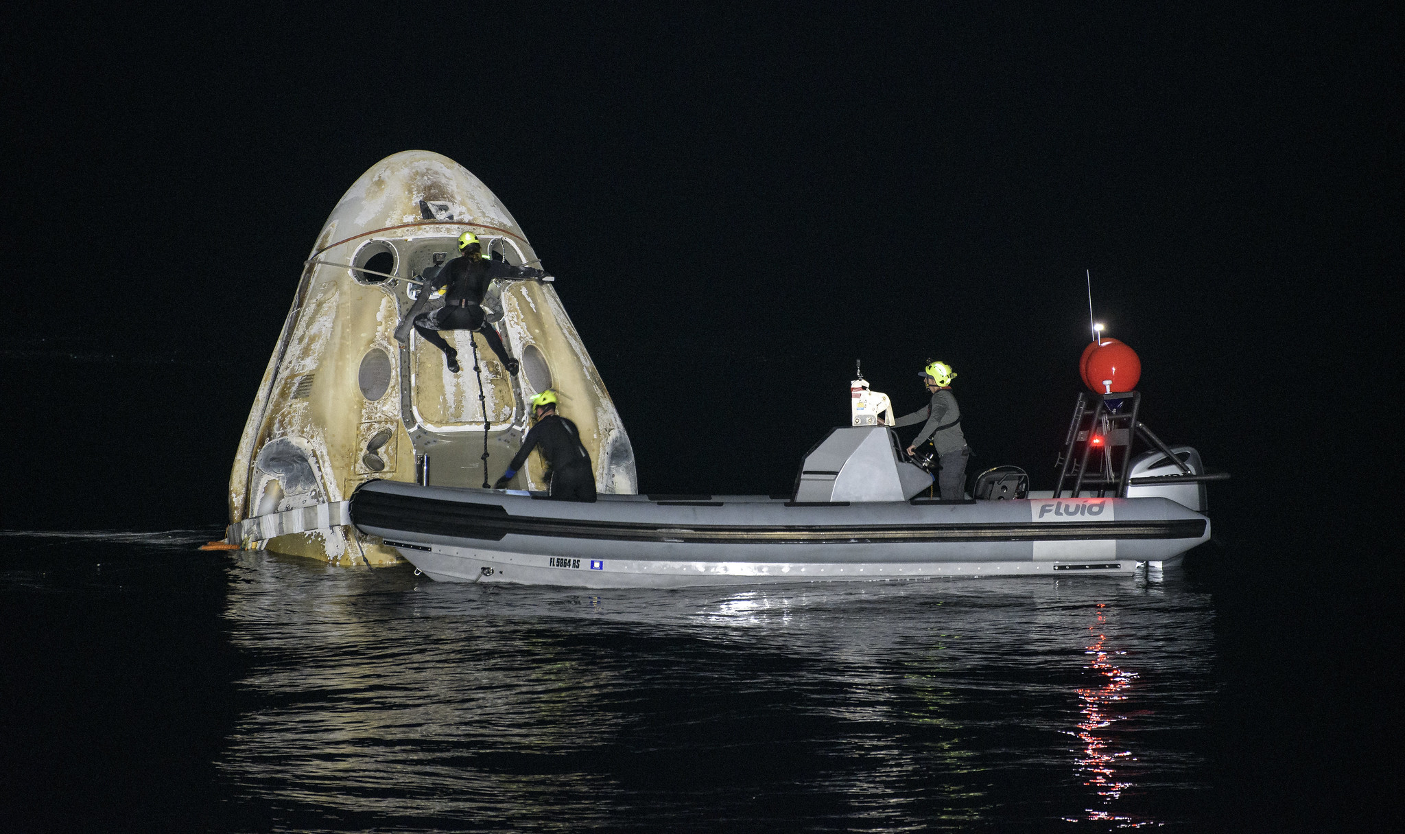NASA Crew-1 Dragon Astronauts Depart ISS for Safe Splashdown Making 1st US Nighttime Landing Since Apollo 8