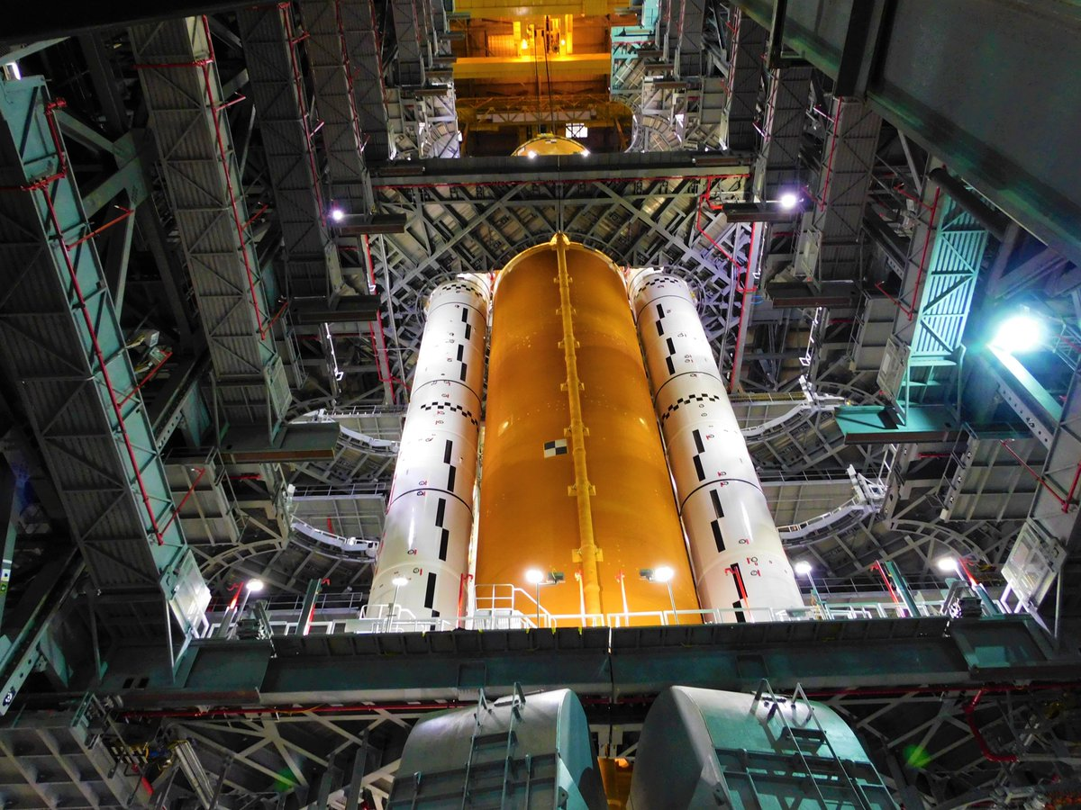 NASA's 1st SLS Core Stage Lifted Vertical and Stacked Beside Boosters in VAB at Kennedy Space Center
